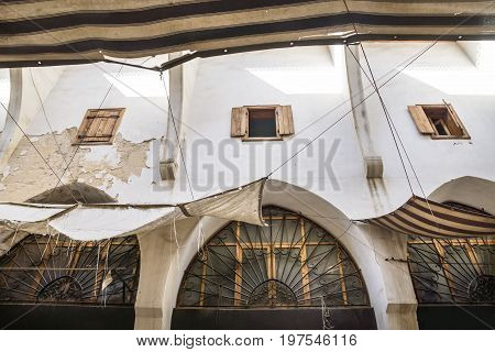 Detail of the walls with arabic windows at the traditional Souks in Tripoli, Lebanon