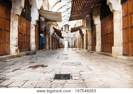Empty traditional Souks street at friday afternoon with roof in Tripoli, Lebanon