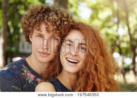 People, Love, Romance And Relationships Concept. Outdoor Close Up Portrait Of Positive Young Caucasi