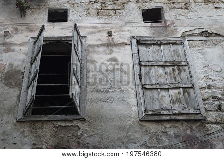 Open and closed wooden abadoned window, Tripoli, Lebanon