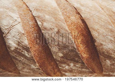 White bread texture crust closeup background, fresh baguette loaf