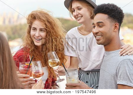 Students Having University-leaving Party Clinking Their Glasses With Wine And Cocktails Being Happy