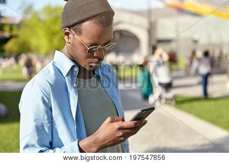 People, Lifestyle And Technology Concept. Stylish Dark-skinned Young Male Wearing Trendy Shades And