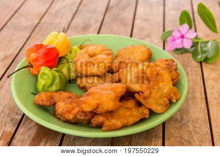 Salt Cod Fritters (accras De Morue) On A Plate With Habanero Peppers In Martinique