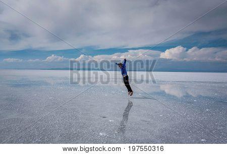 Uyuni, Bolivi March 25, 2017:Man jumping on the lake Salar de Uyuni Bolivia
