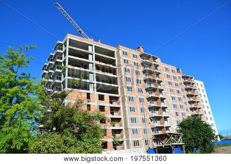 Building construction. Building house with Tower Crane Construction Assembly. House construction.