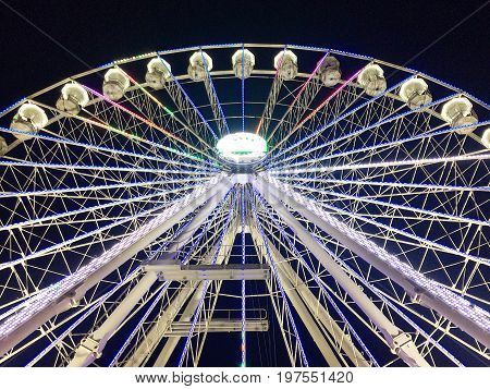 Birmingham, United Kingdom - December 3, 2016: Ferris Wheel, Birmingham. People enjoying the event in front of the Library of Birmingham.