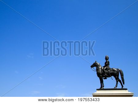 BANGKOK, THAILAND - JULY 30, 2017 : The equestrian statue of King Chulalongkorn (Rama V) with blue sky,Copy space at the left.