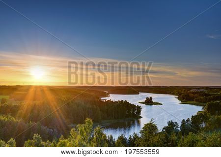 Sun sets over beautiful Jedzelewo Lake. Stare juchy Poland.
