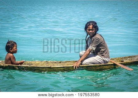 Semporna,Sabah,Malaysia-Apr 23,2017:Sea Gypsy kids on unique handmade boats surrounded by beautiful clear water of the Bodgaya island,Semporna,Sabah,Malaysia