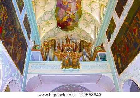 Salzburg, Austria - May 01, 2017: The organ at Saint Peter Abbey Church interior at Salzburg, Austria on May 01, 2017. Founded in 696 it is considered one of the oldest monasteries in the German speaking area.