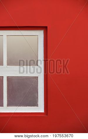 White Wooden Window With Glass Pane In Red Wall