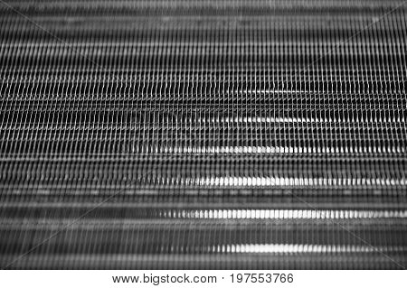 Metallic ribbed seamless texture in blur. Steel. Pattern.