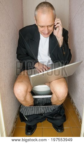 Workaholic Adult Businessman In Toilet