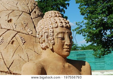Sand Sculpture of Buddha meditating in peace