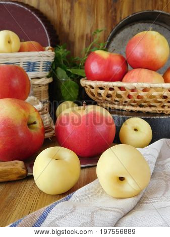 Apples and white nectarines on a wooden table. Fresh harvest