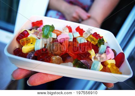 Bowl of gummy bears and other sweets (candy)