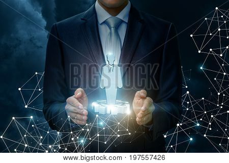 Worker In The Hand Of Businessman.