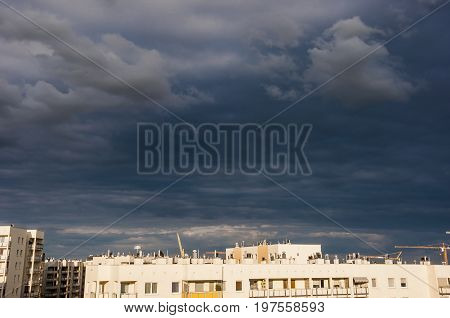 a view on residential buildings wit the stormy clouds