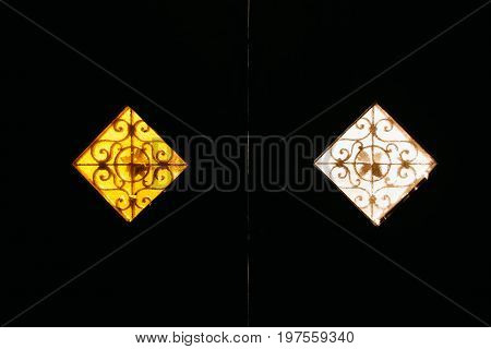 Two vintage windows with a matte glass of yellow and white with beautiful old lattices