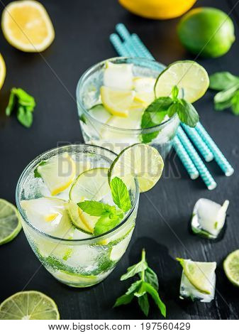 Refreshing summer cocktail with crushed ice and lame with lemon