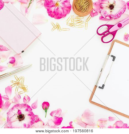 Flat lay fashion feminine home office workspace with clipboard, notebook, pen, pink flowers and accessories on white background. Top view.