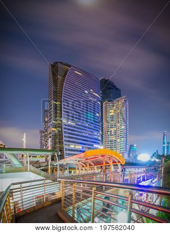 Bangkok - March 5 2017 : Public skywalk with Building architecture style modern of business area in Bangkok. This place is very popular that tourists like to take photos of modern architecture.