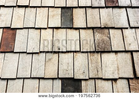 Shingles aged wood background with copyspace. Wooden roof shingles
