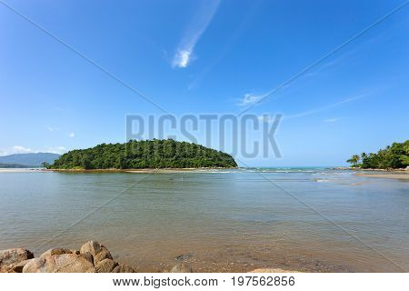 Seascape with small island in andaman tropical sea at phuket thailandfor summer background and design background