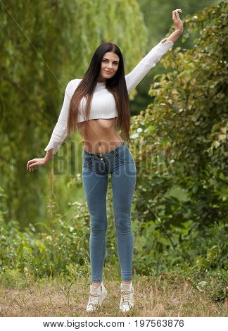 Portrait dreamy and air attractive young woman being playful and carefree with beautiful smile on sunny day. Healthy outdoors lifestyle. Happy female portrait on summer or spring day outside in park.