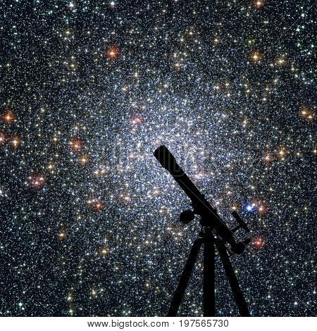 Space Background With Silhouette Of Telescope. Globular Cluster 47 Tucanae,  Ngc 104  In The Constel