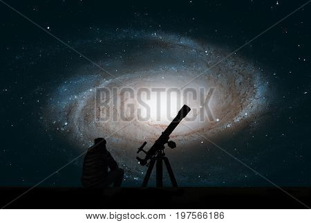 Man With Telescope Looking At The Stars. Bode's Galaxy, M81, Spi