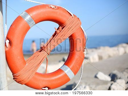 Lifebuoy For People Near Rocks At The Sea