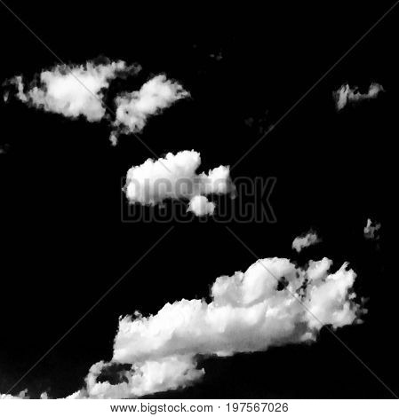 Isolated white clouds on black sky. Set of isolated clouds over black background. Design elements. White isolated clouds. Cutout extracted clouds. Black Background