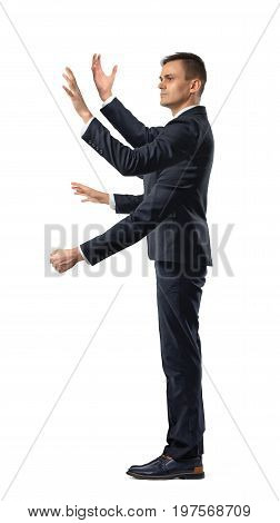A businessman with four hands making grabbing motions and a fist in side view on white background. Multitasking. Time is money. Project managing.