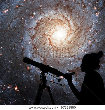Girl Looking At The Stars With Telescope. Messier 74,  Ngc 628 Spiral Galaxy In The Constellation Pi