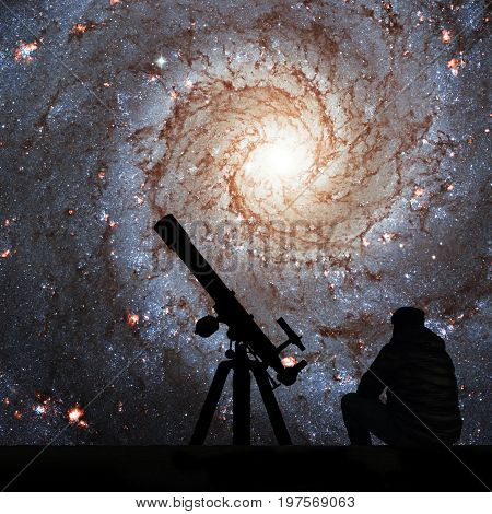 Man With Telescope Looking At The Stars. Messier 74,  Ngc 628 Spiral Galaxy In The Constellation Pis