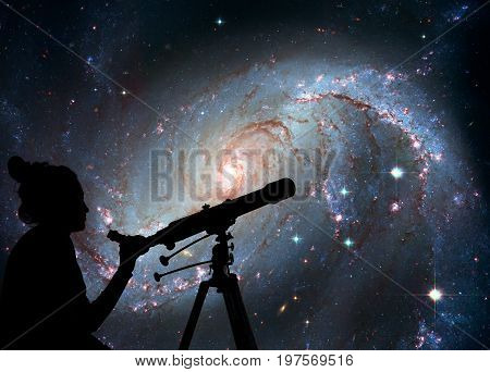 Girl Looking At The Stars With Telescope. Stellar Nursery Ngc 16