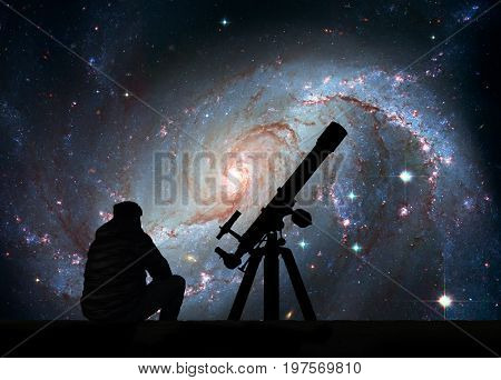Man With Telescope Looking At The Stars. Stellar Nursery Ngc 167