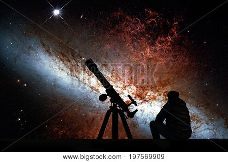 Man With Telescope Looking At The Stars. Messier 82, Cigar Galaxy Or M82 In The Constellation Ursa M