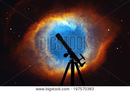 Space Background With Silhouette Of Telescope. The Helix Nebula Or Ngc 7293 In The Constellation Aqu
