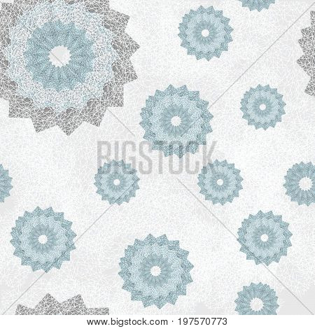 Seamless pattern with ornament of openwork lace round shapes. Geometric background with snowflake effect pale blue and light gray. Delicate, airy, nice, soft, elegant, artistic image