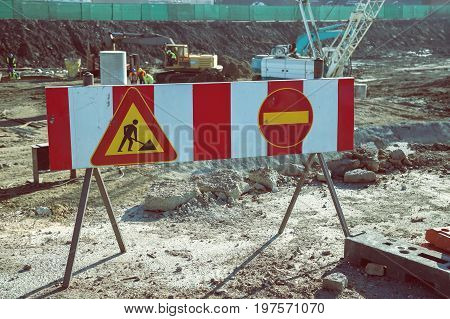Warning Sign In Front Of Construction Site