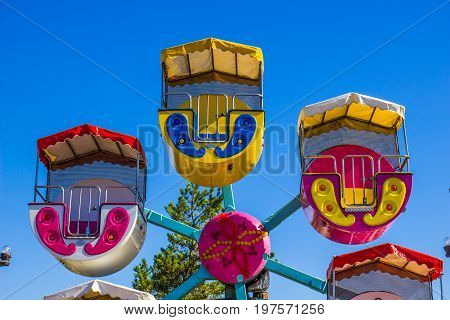 Small Children's Ferris Wheel With Colorful Enclosed Buckets