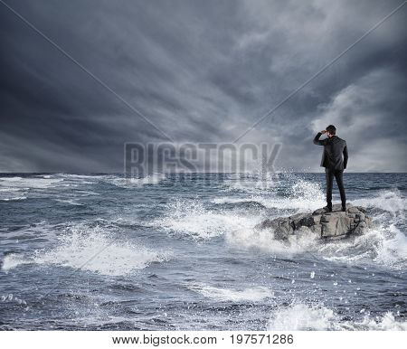 Businessman looking for the future during storm in the sea. Concept of economic crisis and problem in affairs