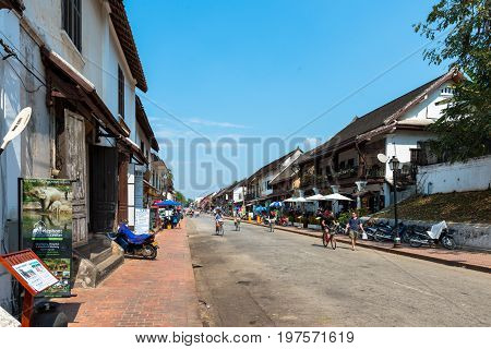 LUANG PRABANG LAOS - MARCH 11 2017: Restaurants and stores at Sisavangvong Road located in the olf Quarter of Luang Prabang Laos.