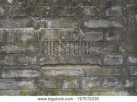 Old Concrete Brick Wall Texture Background -fissures And Moss