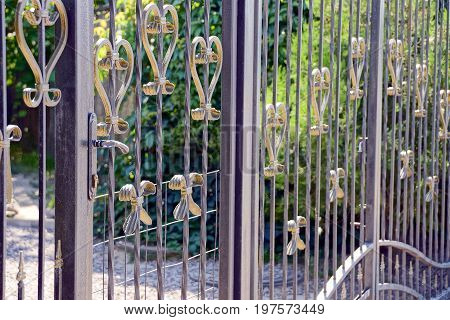 Closed iron gates made of black rods