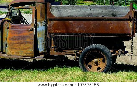 The cab and cargo area of a vintage old truck.
