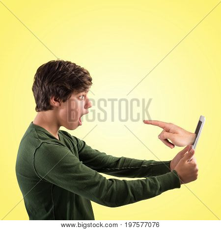 Boy selected or accused by the hand of a stranger that pop-up out of the tablet display